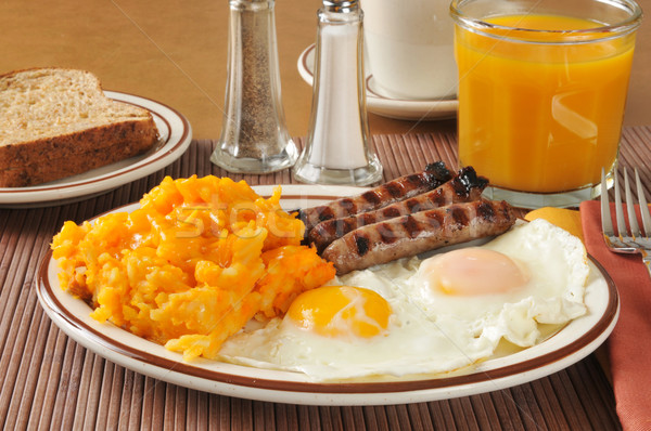 Cheese hash browns with sausage and eggs Stock photo © MSPhotographic