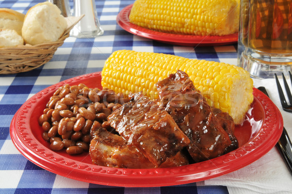 Barbecued ribs with corn on the cob Stock photo © MSPhotographic