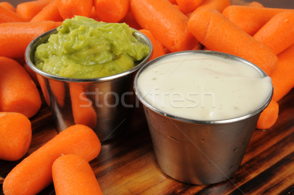 Fresh baby carrots with dips Stock photo © MSPhotographic