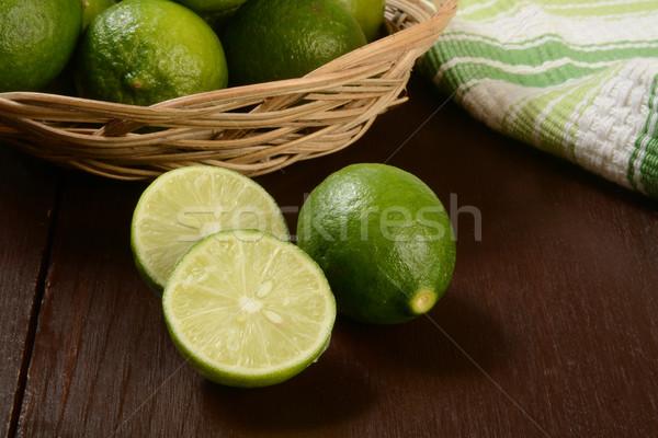 Kulcs kosár rusztikus fa asztal zöld citrus Stock fotó © MSPhotographic