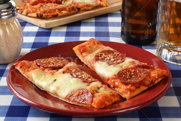 Calabresa pizza alho cerveja beber Foto stock © MSPhotographic