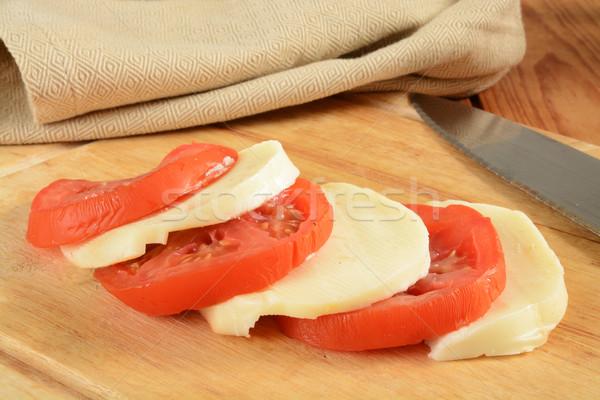 сыра томатный Ломтики моцарелла помидоров разделочная доска Сток-фото © MSPhotographic