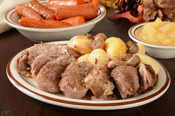 Vesepecsenye szeletel disznóhús baba krumpli ünnep Stock fotó © MSPhotographic