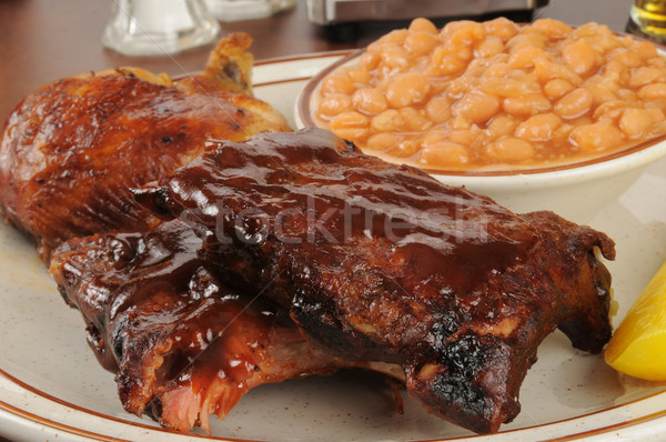 Barbecued ribs and chicken with baked beans Stock photo © MSPhotographic