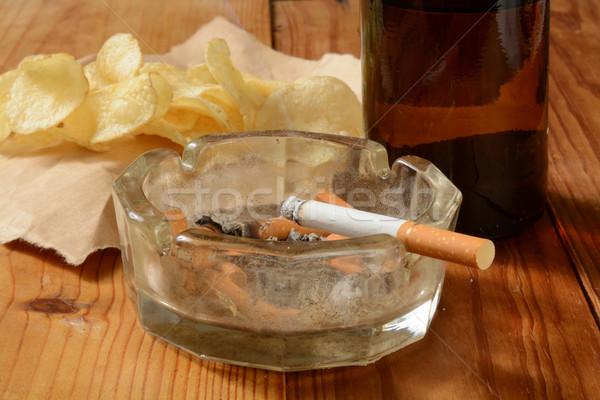 Egészségtelen cigaretta koszos hamu tálca burgonyaszirom Stock fotó © MSPhotographic