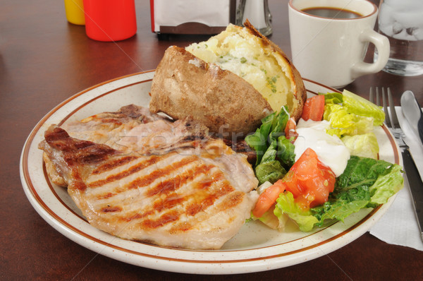 Grilled pork chops with a baked potato Stock photo © MSPhotographic