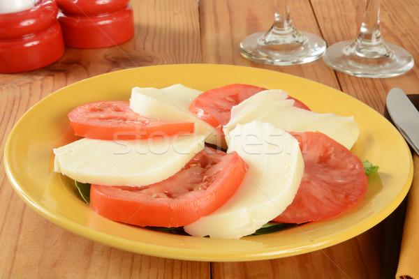 Caprese saláta rusztikus fa asztal zöld piros tányér Stock fotó © MSPhotographic