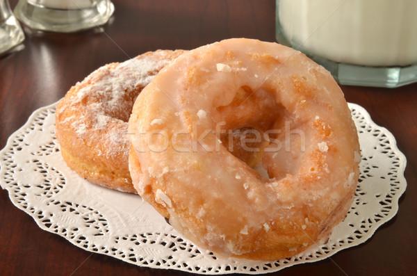 Donuts melk poedersuiker cake glas papier Stockfoto © MSPhotographic