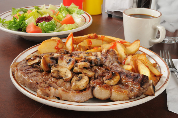 Grilled rib steak with sauteed mushrooms Stock photo © MSPhotographic