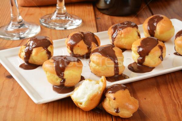 Cream puffs with chocolate sauce Stock photo © MSPhotographic