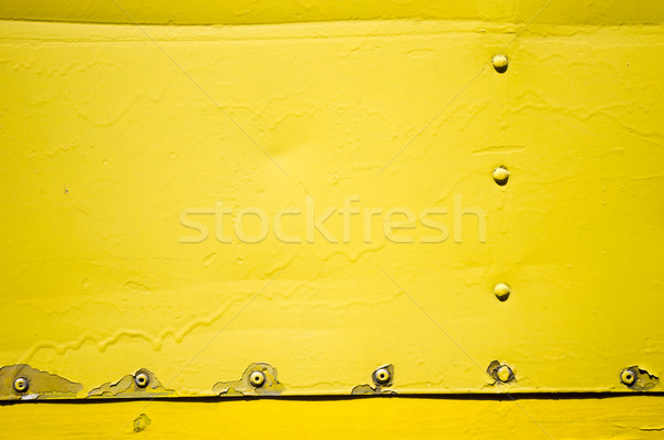 Metal plaka sarı perçin grunge soyut Stok fotoğraf © mtkang
