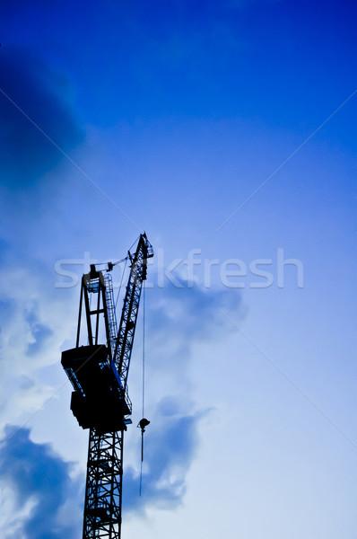 Inşaat vinç siluet tan uzay mavi Stok fotoğraf © mtkang