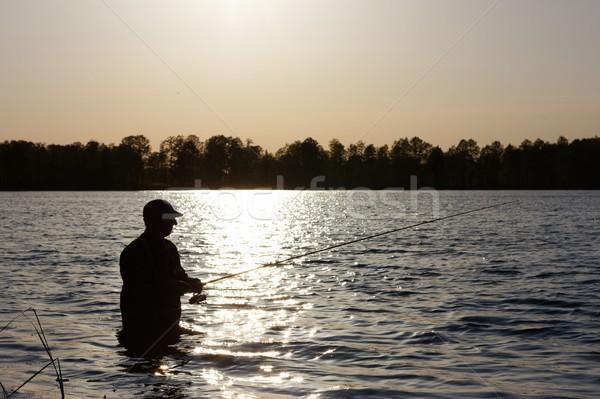 рыбак силуэта Постоянный озеро рыбы Сток-фото © mtmmarek