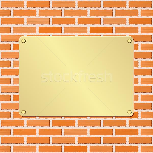 Fogkő arany téglafal fém tányér arany Stock fotó © mtmmarek
