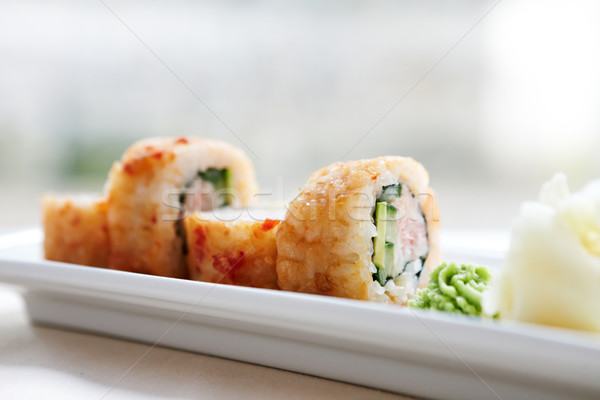 Flying fish roe maki Stock photo © mtoome