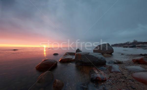 Puesta de sol amplio vista agua nubes Foto stock © mtoome