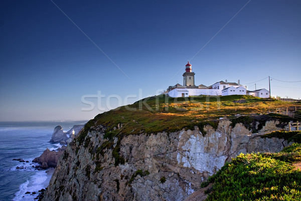 Phare dramatique vue Portugal sunrise Photo stock © mtoome