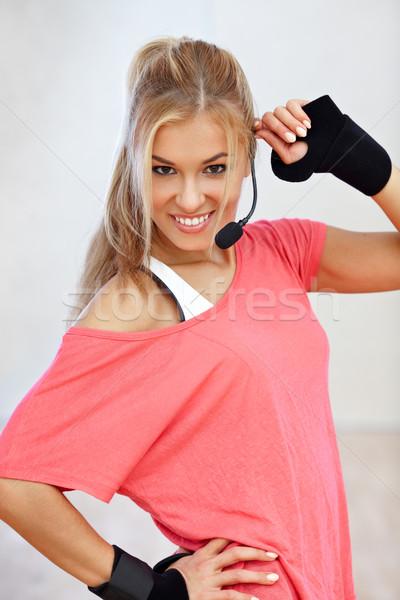 фитнес инструктор улыбаясь женщины спортзал улыбка Сток-фото © mtoome