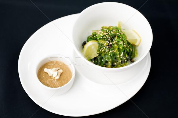 Deniz yosunu salata sos plaka balık yaprak Stok fotoğraf © mtoome
