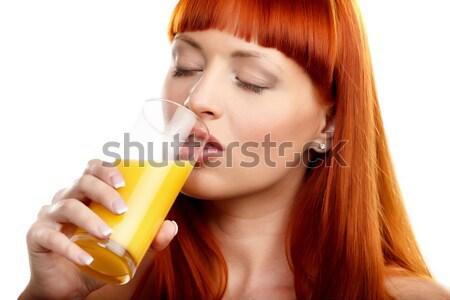 Içme portakal suyu genç kız cam Stok fotoğraf © mtoome