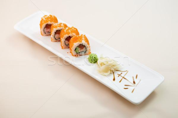 Flying fish roe maki Stock photo © mtoome