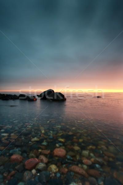 Tramonto ciottoli acqua cielo nubi Foto d'archivio © mtoome