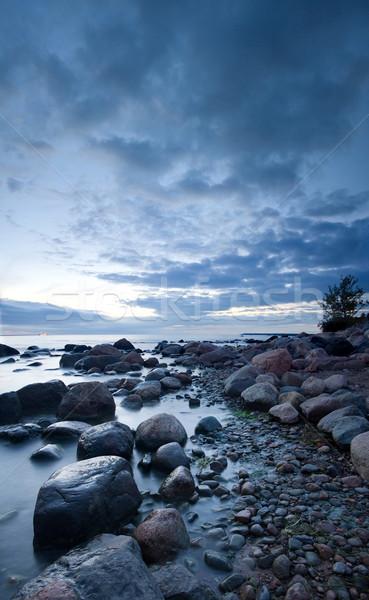 Pedras mar pôr do sol misterioso ver Foto stock © mtoome