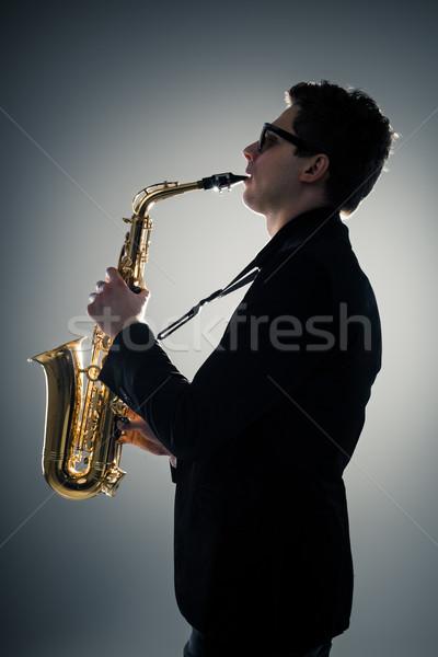 Saksofon młody człowiek gry ciemne człowiek Zdjęcia stock © mtoome