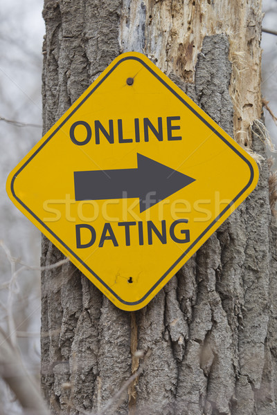 Online Dating Arrow sign on a tree Stock photo © mybaitshop