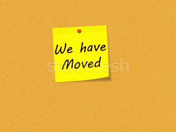 We have Moved on Yellow Sticky note on Corkboard Stock photo © mybaitshop