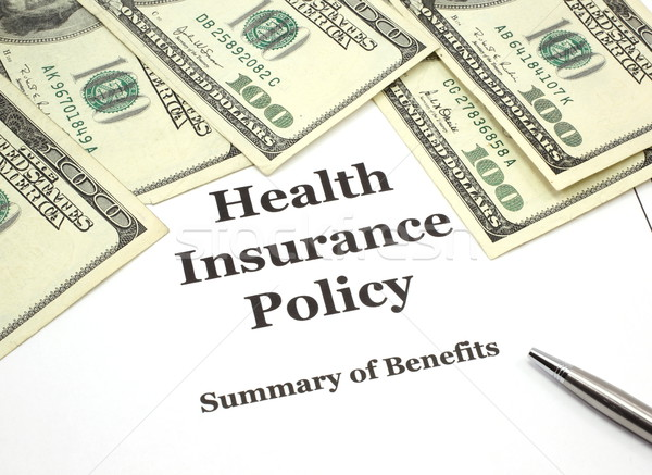 Health Insurance Policy and Cash Stock photo © mybaitshop