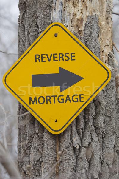 Reverse Mortgage Arrow sign on tree Stock photo © mybaitshop