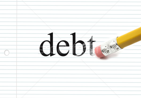 Erasing Debt on Notebook paper Stock photo © mybaitshop