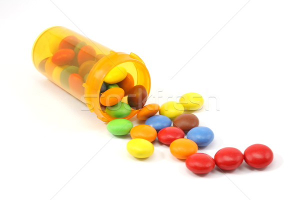 Candy spilling out of pill bottle Stock photo © mybaitshop
