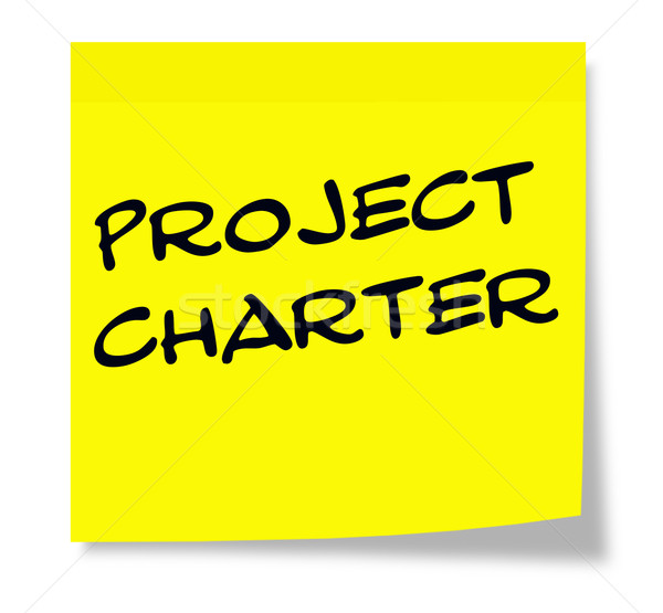 Project Charter written on a yellow sticky note Stock photo © mybaitshop