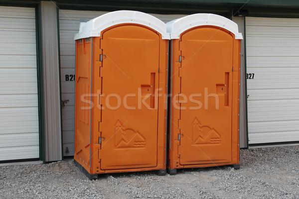 Two orange Porta Pottys Stock photo © mybaitshop