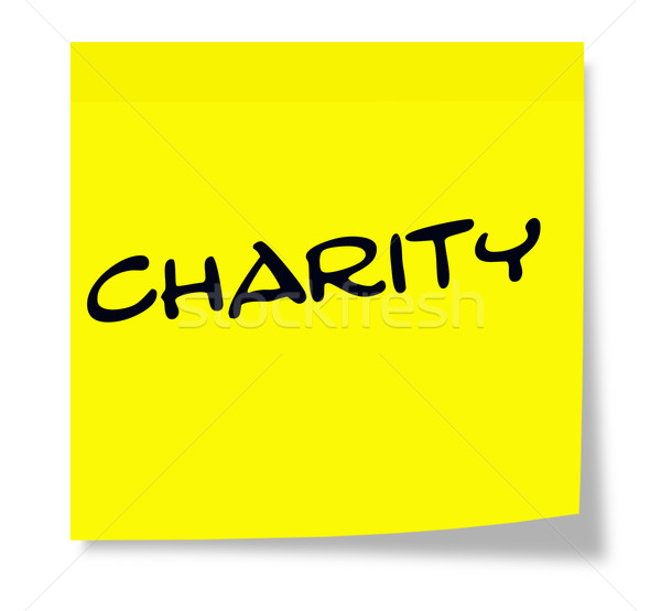 Charity written on a yellow sticky note Stock photo © mybaitshop