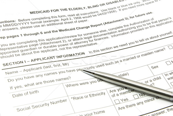 Medicaid Application and Silver Pen Stock photo © mybaitshop