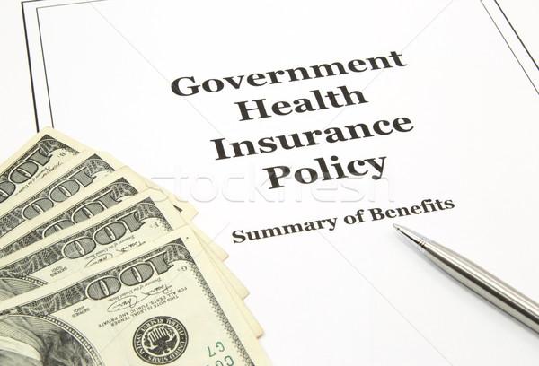 Kormány egészségbiztosítás irányvonal pénz száz dollár Stock fotó © mybaitshop