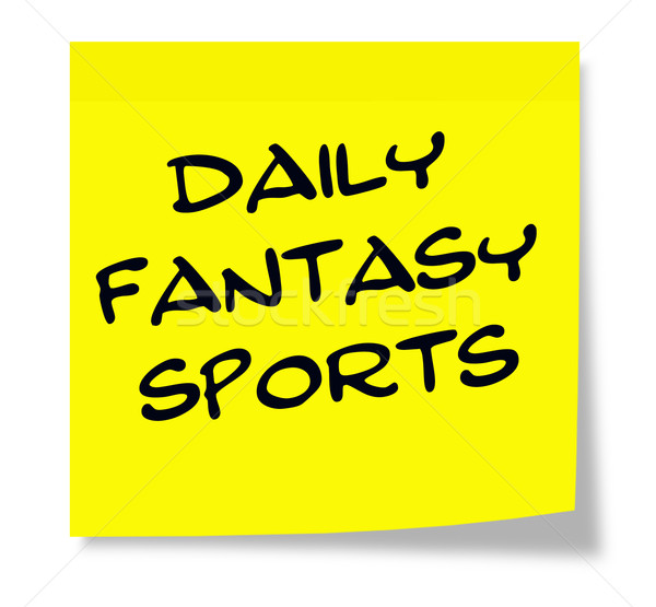 Daily Fantasy Sports written on a yellow sticky note Stock photo © mybaitshop