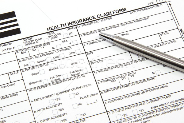 Health Insurance Claim Form with Silver Pen Stock photo © mybaitshop