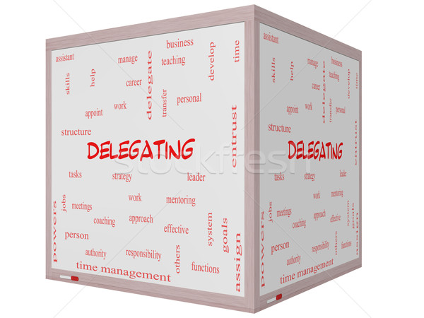 Delegating Word Cloud Concept on a 3D cube Whiteboard Stock photo © mybaitshop