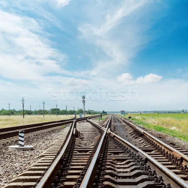 Ferrovia nublado céu estrada paisagem assinar Foto stock © mycola