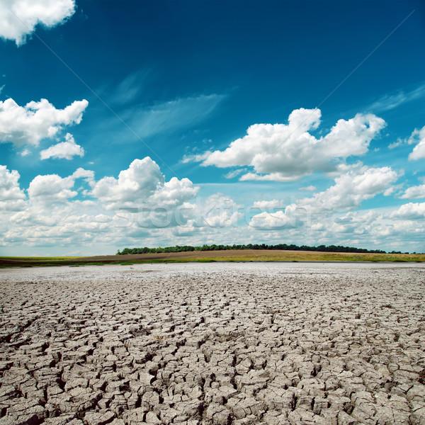 Mavi dramatik gökyüzü kırık çöl doku Stok fotoğraf © mycola