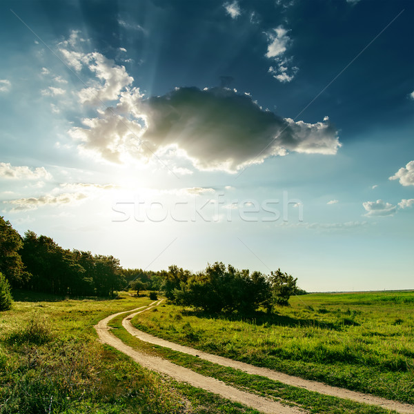dirty road and sunset over it Stock photo © mycola