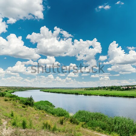 green landscape with river and cloudy sky with sun Stock photo © mycola