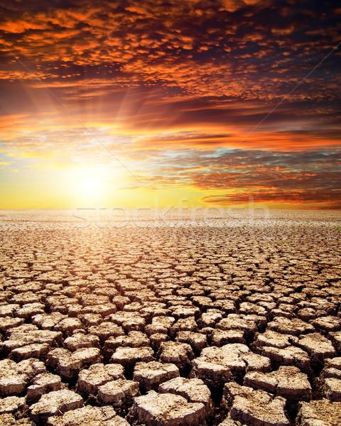 Seca terra vermelho pôr do sol luz deserto Foto stock © mycola