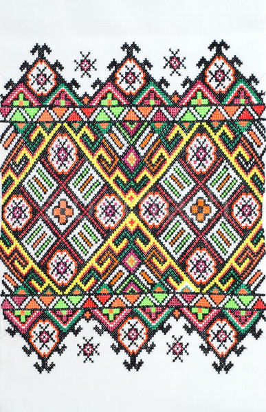 embroidered good by cross-stitch pattern. ukrainian ethnic ornament Stock photo © mycola
