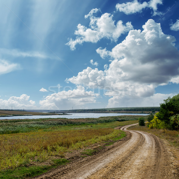 winding country road and clouds in blue sky Stock photo © mycola