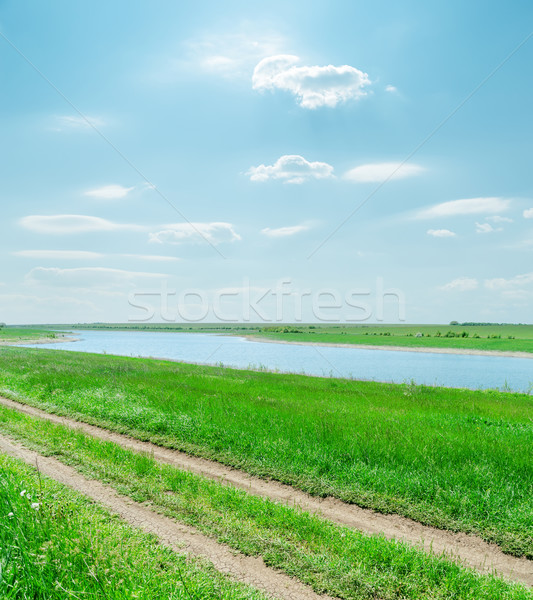 sunny sky with clouds and green landscape with river and road Stock photo © mycola